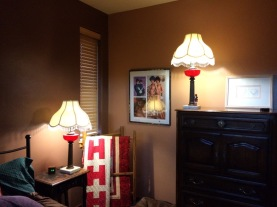 The lamps from Penny's grandparents, the H quilt on the quilt rack, and centerfold of the twins in my shrine.
